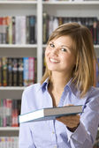Shop assistant in the bookshop — Stock Photo