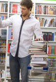 Student shops in a bookshop — Stock Photo