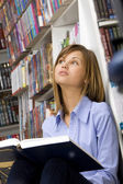Young woman dreaming with big book — Stock Photo