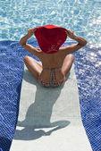 Beautiful woman in bikini relax in the pool — Stock Photo
