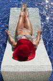 Beautiful woman in bikini suntan in the pool — Stock Photo