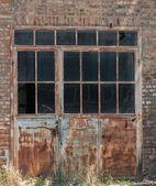 Old factory door — Stock Photo