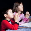 Stock Photo: Brother and sister say prayers.