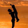 Mother holds son up. — Stock Photo
