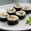 Korean sushi and a parsley leaf. — Stock Photo