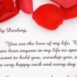 Rose petals and a love letter. — Stock Photo #4897809