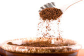 Pouring coffee grounds. — Stock Photo