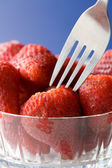 Close up of a fork in strawberries. — Stock Photo