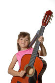 Fille tient la guitare en image studio. — Photo