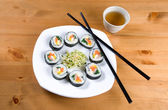 Korean style sushi and tea. — Stock Photo