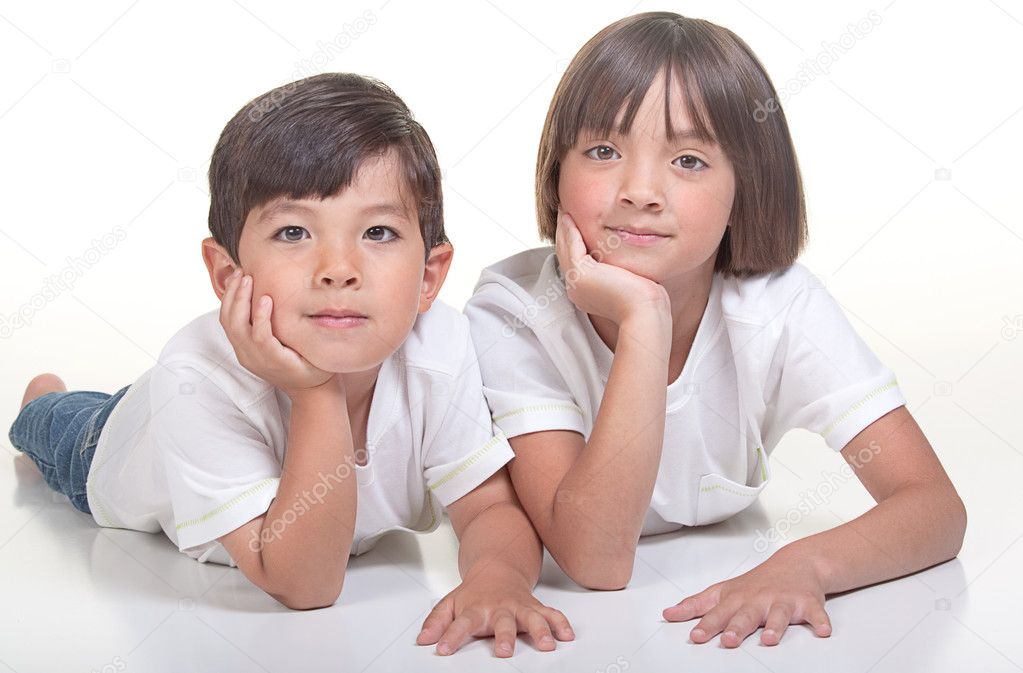 A studio portrait of a brother and sister. — Stock Photo #4897637