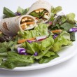 Stock Photo: Veggie wrap on fresh salad.