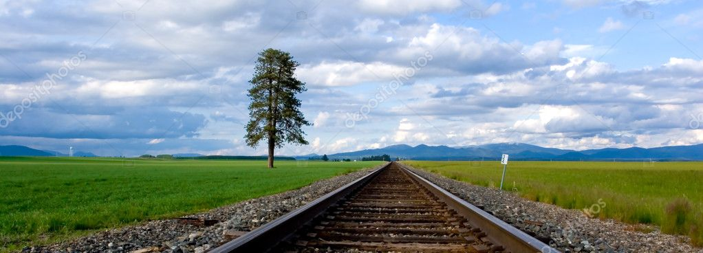 A panoramic image of railroad tracks running through a farm field in North Idaho. — Stock Photo #4913031
