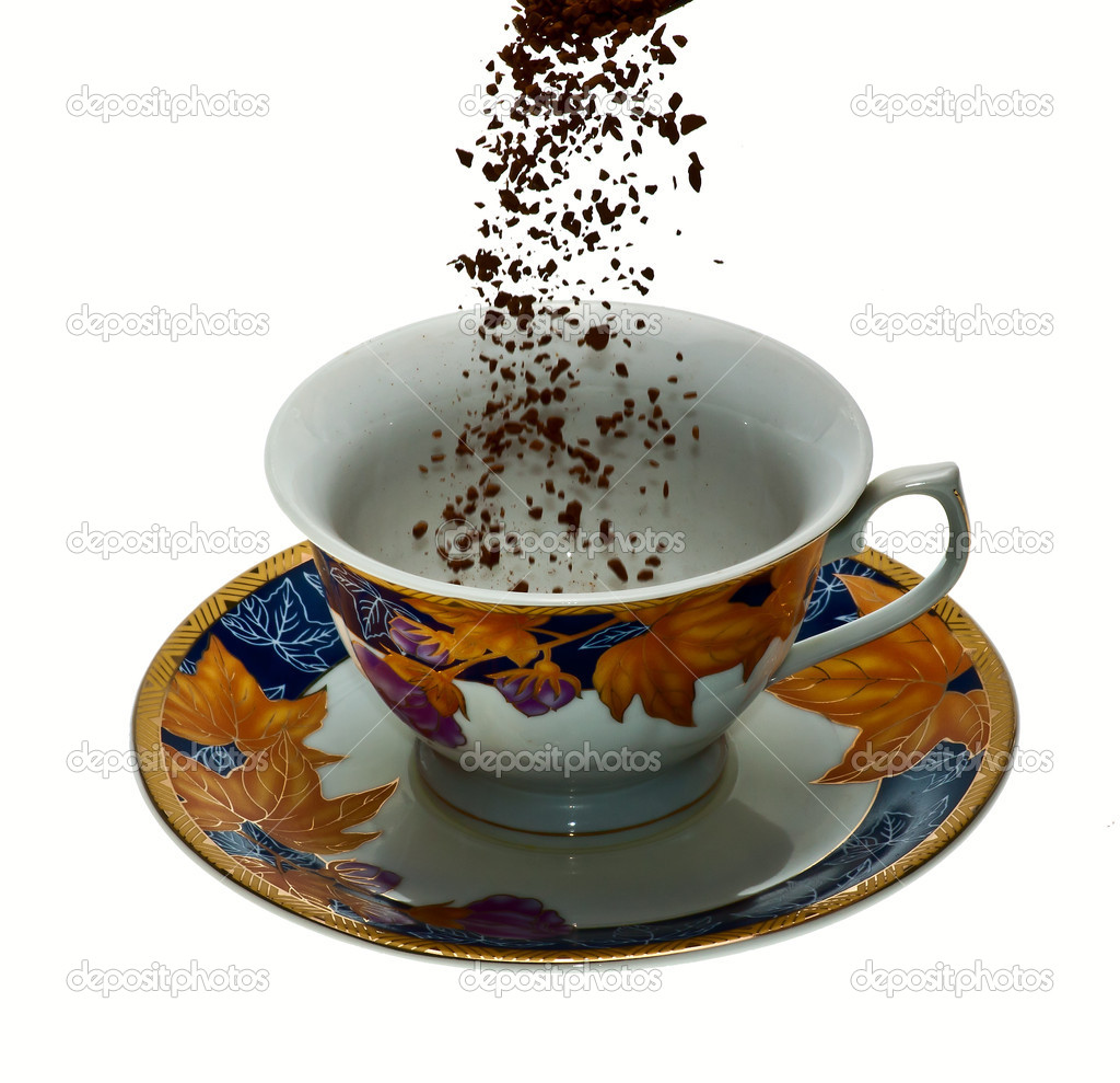To fill the coffee and sugar in a white Cup is isolated — Stock Photo #4913081