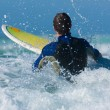 Surfer with his board in the — Stock Photo