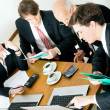 Businesspeople crunching the - Stock Photo