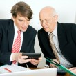 Businesspeople crunching the — Stockfoto