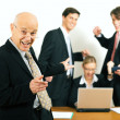 Stock Photo: Businesspeople crunching the