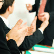 Business team applauding after — Stock Photo #5023075