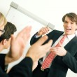 Business team applauding after — Stock Photo #5023077