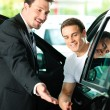 Mbuying car in dealership — Stock Photo #5023297