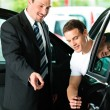 Stock Photo: Man buying a car in dealership