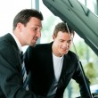 Man buying a car in dealership — Stock Photo