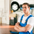 Auto mechanic standing in his — Stock Photo #5023347