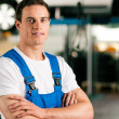 Auto mechanic standing in his - Stock Photo