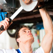 Auto mechanic standing in his — Stock Photo #5023354