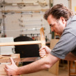 Carpenter working on a hand — Stock Photo #5023394