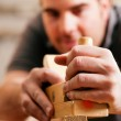 Carpenter working with a — Stock Photo #5023424