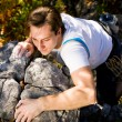 Royalty-Free Stock Photo: Man climbing a rock short