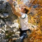 Man climbing a rock short — Stock Photo #5023445