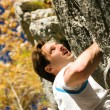 Man climbing a rock short — Stock Photo #5023446