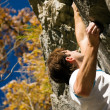 Man climbing a rock short — Stock Photo #5023448