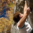 Man climbing a rock short — Stock Photo #5023449