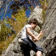 Man climbing a rock short — Stock Photo #5023450