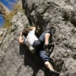Man climbing a rock short — Stock Photo #5023453