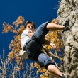 Man climbing a rock short — Stock Photo #5023454