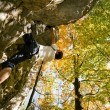 图库照片: Man climbing a rock short