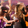 Dance action in a disco club - Stock Photo