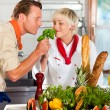 Two chefs in teamwork - man — Stock Photo #5023535