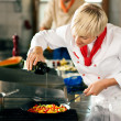 Stock Photo: Two chefs in teamwork - man