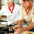 Two chefs in teamwork - man — Stock Photo #5023552