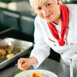 Female Chef in a restaurant or - Stock Photo