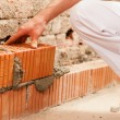 Bricklayer laying bricks to make — Stock Photo #5023569
