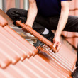 Roofing - construction worker - Stock Photo