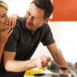 Stock Photo: Young couple cooking