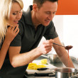 Royalty-Free Stock Photo: Young couple cooking